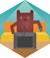 A bear watching television