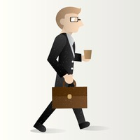 Businessman holding briefcase and cup