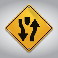 Divided highway ahead road sign