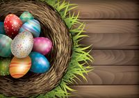 Easter eggs in nest on wooden board