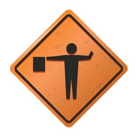 Flagger road sign