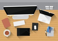 Office desk with computer, gadgets and stationery