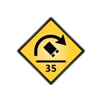 Truck rollover warning with speed advisory sign