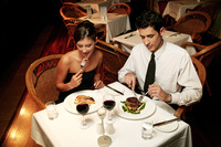 A couple in dinners wear celebrating their anniversary by eating in the restaurant