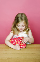 A girl wrapping present