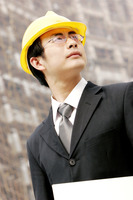 A man with safety helmet at a construction site