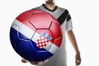 A soccer player holding croatia soccer ball