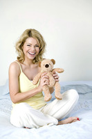 A woman holding a teddy bear