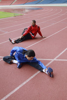 Athletes warming up on running track