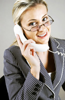 Bespectacled business woman talking on the phone