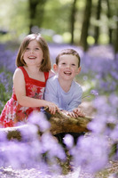 Boy and girl in field of flowers