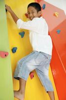 Boy climbing rock wall