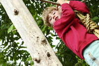 Boy holding on to a rope