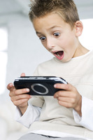 Boy playing with portable video game