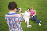 Boy recording images of young couple