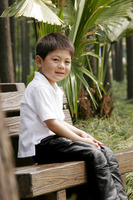 Boy sitting on the bench smiling