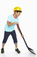 Boy using a shovel
