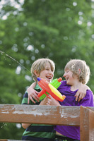 Boys playing with water guns
