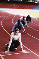 Business people crouching on starting line