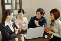Business people having discussion in a restaurant