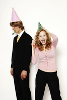 Businessman and businesswoman in party hat