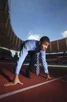Businessman crouching on starting line