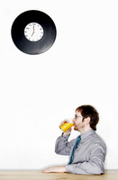 Businessman drinking a glass of orange juice