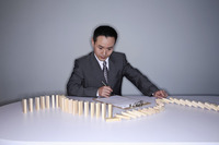 Businessman examining wooden blocks on the table