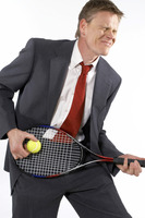 Businessman holding a tennis racquet and ball like playing a guitar