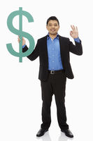 Businessman holding up a dollar sign and showing hand gesture