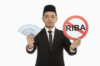 Businessman holding up an anti-riba
