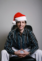 Businessman in christmas hat smiling at the camera