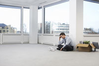 Businessman in empty office space