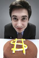Businessman looking excited to eat cake with dollar sign