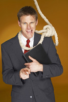Businessman pointing at the camera while a rope hanging around his neck