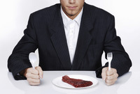 Businessman preparing to eat his meal