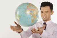 Businessman reaching out for the globe
