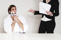 Businessman shaving his beard in the office