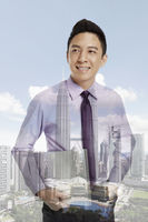 Businessman standing against a cityscape background