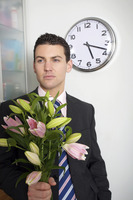 Businessman with a bouquet of flowers