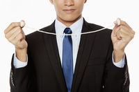 Businessman with a string tied to his fingers