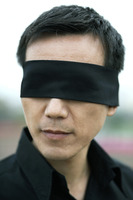 Businessman with his eyes being blindfolded
