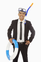 Businessman with swimming gear smiling