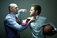 Businessmen fighting during basketball competition