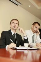 Businessmen talking on the phone