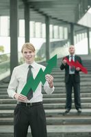 Businessmen with arrow signs