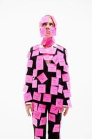 Businesswoman covered with adhesive notes looking up and thinking