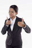 Businesswoman giving two thumbs up