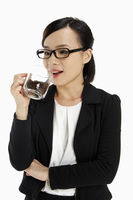Businesswoman holding a cup filled with coffee beans