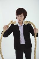 Businesswoman holding broken rope